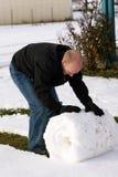 Rotolando sulla neve Immagine Stock