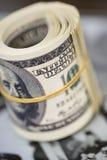 Rotoli cento banconote in dollari Banconota americana dei soldi Fotografia Stock