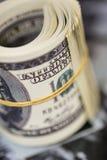 Rotoli cento banconote in dollari Banconota americana dei soldi Fotografie Stock Libere da Diritti