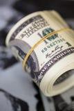 Rotoli cento banconote in dollari Banconota americana dei soldi Fotografie Stock