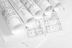Rotoli dei disegni architettonici Fotografie Stock