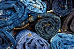 Rotoli dei pantaloni dei jeans Fotografia Stock