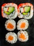 Rotoli di sushi di uramaki e di Maki Fotografia Stock