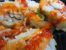 Rotoli di sushi giapponesi caldi e piccanti Fotografie Stock