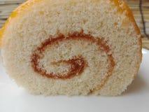 Rotolo arancio del dolce Immagini Stock