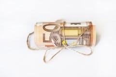 Rotolo di euro nastro del cavo della cordicella e dei soldi Fotografia Stock