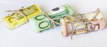 Rotolo di euro nastro del cavo della cordicella e dei soldi Immagini Stock