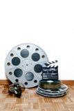 Rotolo di film del cinema con la valvola e le bobine Fotografie Stock Libere da Diritti