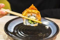 Rotolo di sushi con il bastoncino Fotografia Stock
