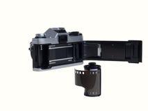 Rotolo di vecchia pellicola con la macchina fotografica. Fotografia Stock Libera da Diritti