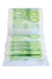 Rotolo svolto del peper della toilette con 100 euro banconote Fotografie Stock
