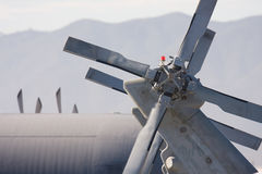 Rotor. Rear helicopter rotor an a military with mountains in the background Royalty Free Stock Image