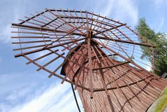 Rotor of Ancient Wooden Windmill. Ancient red wooden windmill with uncommon rotor. Western Finland Royalty Free Stock Images