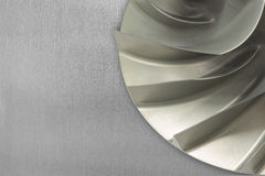 Rotor blade of centrifugal type gas compressor placed on aluminum sheet. Stock Photos