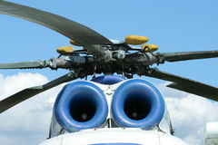 Rotors and engines of russian helicopter MI-8. A photo of top part of Russian helicopter MI-8, front view. Following components are visible: engines, blades Royalty Free Stock Images