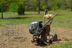 Rototiller in the garden. Rototiller in the vegetable garden Royalty Free Stock Photos