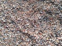 Rots en zand op strandachtergrond Stock Afbeelding