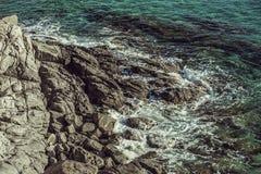 Rotsachtig Strand Stock Afbeeldingen