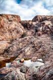 Rotsen en stenen dichtbij Noordpooloceaan Royalty-vrije Stock Foto