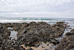 Rotsen en Zand op het strand stock afbeeldingen