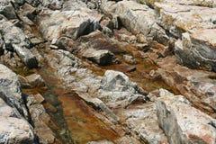 Rotsen met water Stock Foto