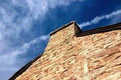 Rotsmuur en Schoorsteen Stock Foto