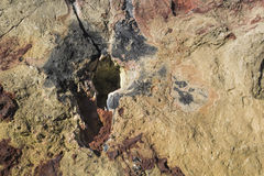 Rotsmuur met zeer belangrijk gat Stock Afbeeldingen
