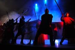 Rotsopera, kostuumspel levend op het stadium Stock Afbeelding