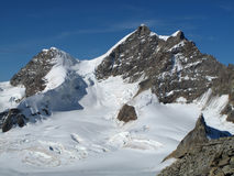 Rottalhorn and jungfrau. Rottalhorn and jungrau viewed from Jungfraujoch in the bernese oberland stock photography