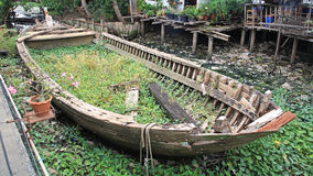 Rotted and abandoned row wooden boat. At Thai village Royalty Free Stock Photos