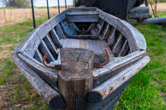 Rotted wooden fishing boat. On the grass Stock Photography