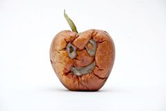 Rotten apple , human face, aging concept Royalty Free Stock Photography