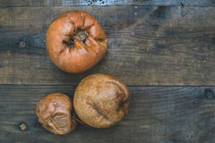 Rotten apples on wood Royalty Free Stock Photography
