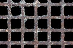 Rusty, battered manhole cover pattern royalty free stock image