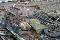 Rotten boat with engine Royalty Free Stock Photo