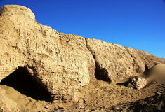 Rotten city wall in desert royalty free stock photography