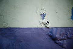 Rotten concrete wall with blown paint Stock Image