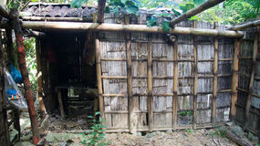 Rotten and dirty hut. A front view of a rotten and dirty hut with the entrance at the left and some rubbish plastic bags being hung on the left. Photo taken on Royalty Free Stock Images