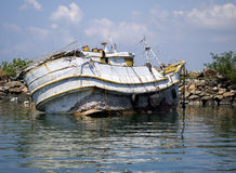 Rotten fisher boat at the beach in the morning light Royalty Free Stock Photos