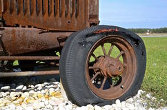 Rotten flat tractor tire Stock Photos