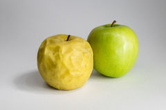 Rotten and fresh apple Stock Photos