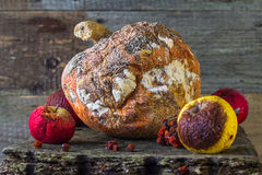Rotten fruit wooden board Stock Images
