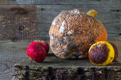 Rotten fruit wooden board Stock Photo
