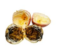 Rotten and good inside ripe passion fruits. Isolated on white background stock photo