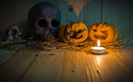 rotten Halloween pumpkin with candle light on Wooden background Stock Image