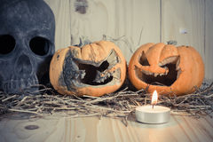 rotten Halloween pumpkin with candle light on Wooden background Stock Photos