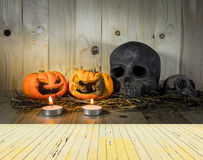 rotten Halloween pumpkin with candle light on Wooden background Royalty Free Stock Images