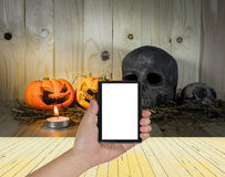 rotten Halloween pumpkin with candle light on Wooden background Royalty Free Stock Photos