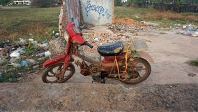 Rotten moped. Old rotten moped in otres village in cambodia Stock Photo