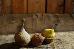 Rotten pears. On a wooden background Stock Image
